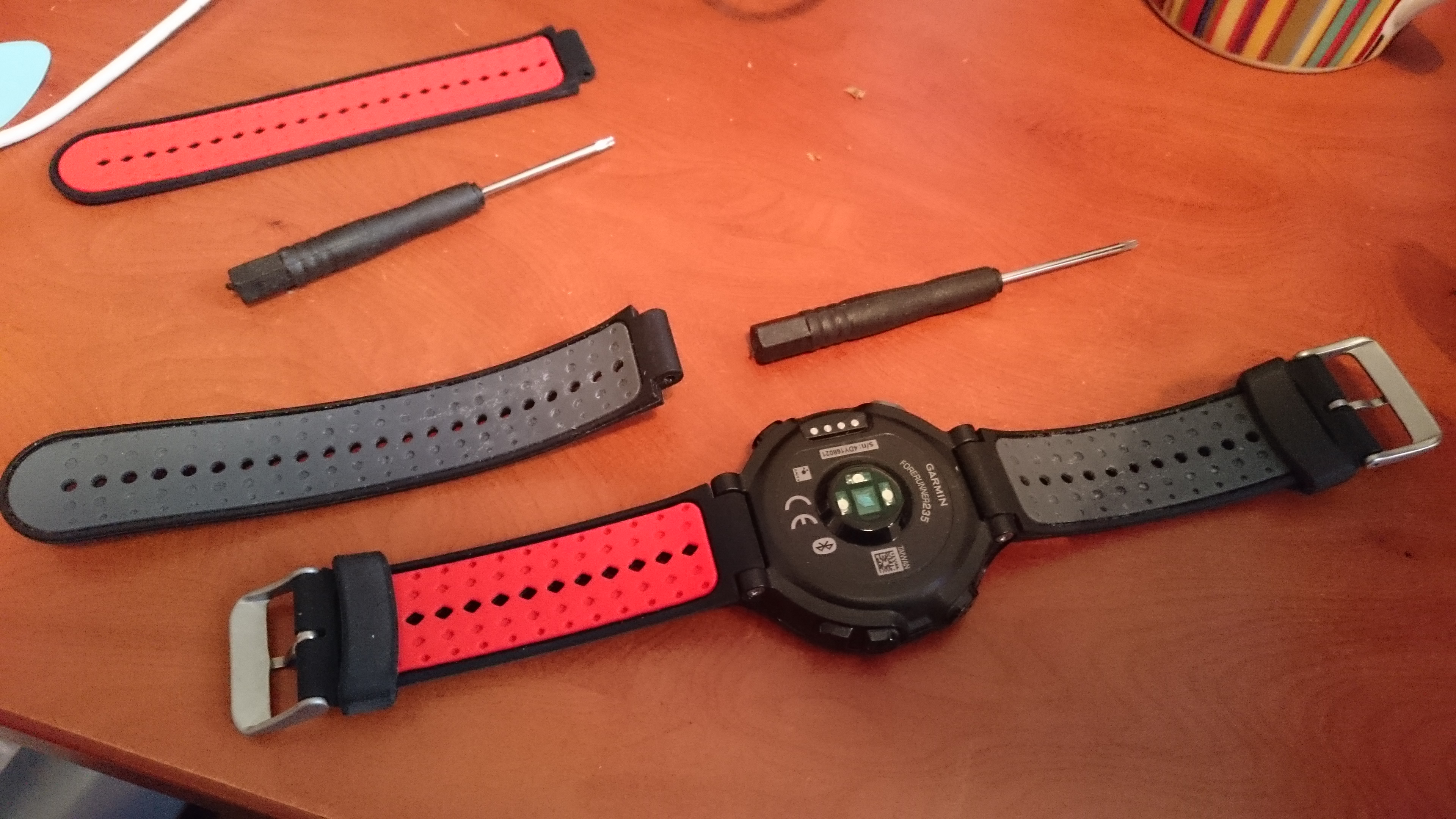 """I remove the """"tongue"""" part of the strap from my watch (i.e. the non-buckle part), and replace it with the buckle part of the new strap. Yes, the watch now has two buckles on it."""